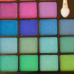 Brushes on eye shadows palette — Stock Photo #66373499