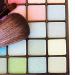 Brushes on eye shadows palette — Stock Photo #66378323