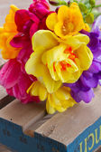 Posy  of spring flowers on wooden table — Stock Photo