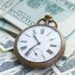 Money and time — Stock Photo #67788085