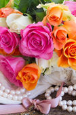 Pink and orange roses with lace — Stock Photo