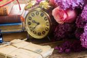 Antique  clock with pile of mail — Стоковое фото
