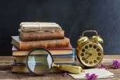 Pile of books with clock — Stock Photo