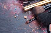Brushes on eye shadows palette — Stock Photo