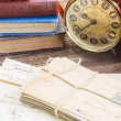 Antique  clock with pile of mail — Stock Photo #76687603