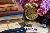 Antique  clock with pile of mail — Stock Photo