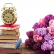 Pile of books with clock — Stock Photo #77005979