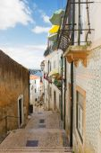 Street in old town of Lisbon — Stock Photo