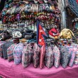 Постер, плакат: Nepali national hats at market