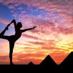 Yoga near Egyptian Pyramids — Stock Photo #54564887