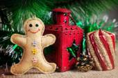 Gingerbread toy near Christmas tree — Stock Photo