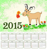 Calendar for 2015 with a goat on a green grunge background — Vector de stock