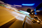 Car in motion at night — Stock Photo