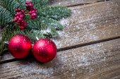 Christmas background with a red ornament, berries and fir in snow — Stock Photo