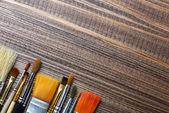 Brushes on wood background — Stock Photo