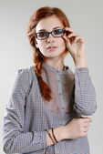 Red hair girl with glasses — Stock Photo