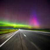 Northern lights (Aurora borealis) on road. Russia. Izhevsk 17.03.2015 — Stock Photo