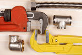 Fitting and two adjustable wrenches for plumbing works — Stock Photo