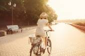Girl riding bicycle in park — Stock Photo