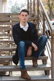 Fashionable handsome man model posing — Stock Photo