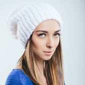 Fashionable girl in winter knitted clothes — Stock Photo