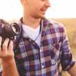 Young Man with retro photo camera outdoor hipster Lifestyle — Stock Photo #60030479