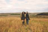Landscape portrait of young beautiful stylish couple sensual and — Стоковое фото