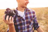 Young Man with retro photo camera outdoor hipster Lifestyle — Stock Photo