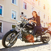 Biker girl in a leather jacket on a motorcycle — Foto de Stock