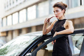 Attractive girl standing near the car — Stock Photo