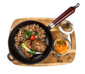 Restourant serving dish - cutlet with buckwheat on wooden board  — Stock Photo