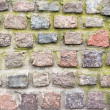 Old wall of colored stones — Stock Photo #66386767