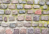 Old wall of colored stones — Stock Photo