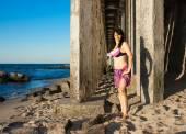 Woman in bikini on the beach — Stock Photo