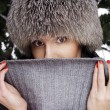Young woman near new year tree wearing warm hat — Stock Photo #56427329
