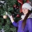 Young beautiful woman near new year tree with present — Stock Photo #58376671