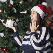 Young beautiful woman near new year tree with present — Stockfoto #58376713