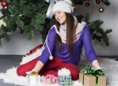 Young woman near new year tree with present — Stock Photo