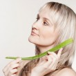 Young beautiful woman with aloe — Stock Photo #65916447