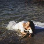 Portrait of young beautiful bride near sea — Stock Photo #66644991