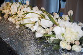 Picture of wedding bouquet of white roses on table as decor — Stock Photo