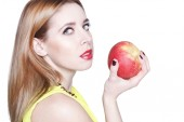 Portrait of young beautiful woman with an apple — Foto de Stock