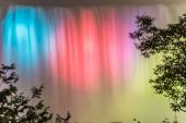 Niagara Falls lit up at night in different colors  — Stock Photo