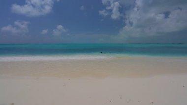 Man swims on the back in caribbian sea. — Stock Video