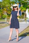 Red-haired girl in a hat and sunglasses — Stock Photo