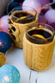 Two cups of delicious tea in yellow knitted sweater — Stockfoto