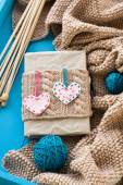 Old notebook with knitted cover with felt heart next to the brig — Stock Photo