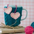 Blue cup in a blue sweater with felt hearts — Stock Photo #62085167