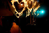 Evening street performance with fiery torches in the form of hea — Stockfoto