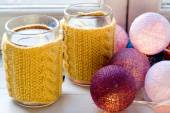 Two cups of delicious tea in yellow knitted sweater  — Стоковое фото